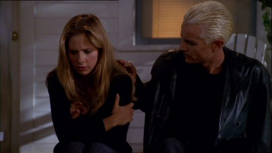 Spike patting Buffy on the shoulder from Buffy: The Vampire Slayer