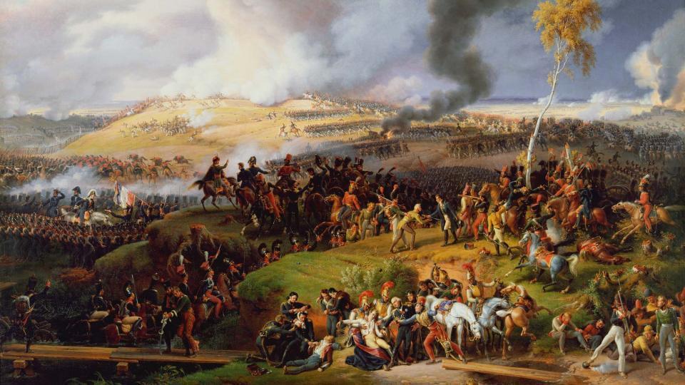 Armies clashing on hilly terrain.