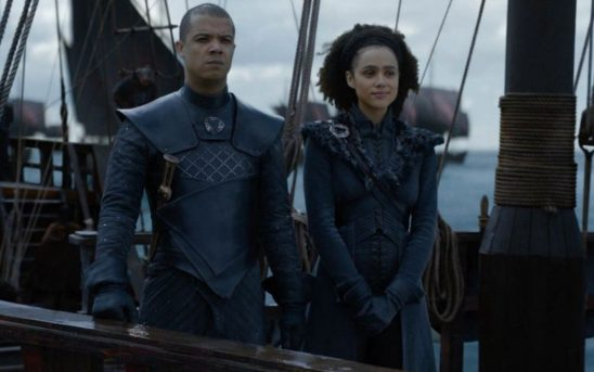 A young black man and woman in leather armor stand next to each other