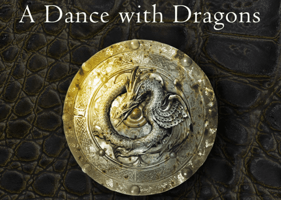 Cover art from A Dance With Dragons showing a shield with a dragon emblem.