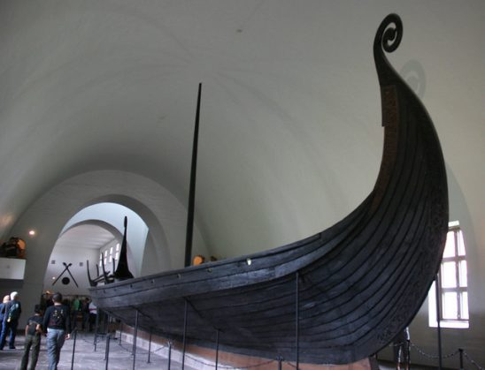 The hull of a Viking long ship in a museum.