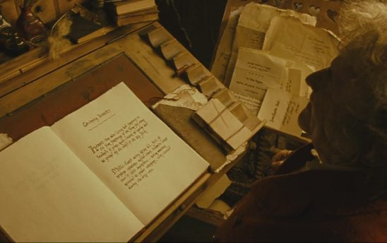 Bilbo writing his book.