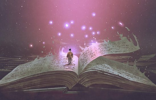 A tiny person stands in the center of a magical book.