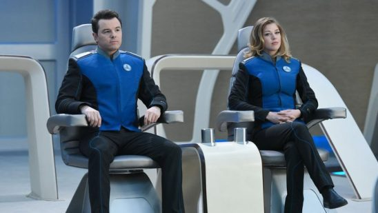 Mercer and Grayson sitting on the bridge of the Enterprise.