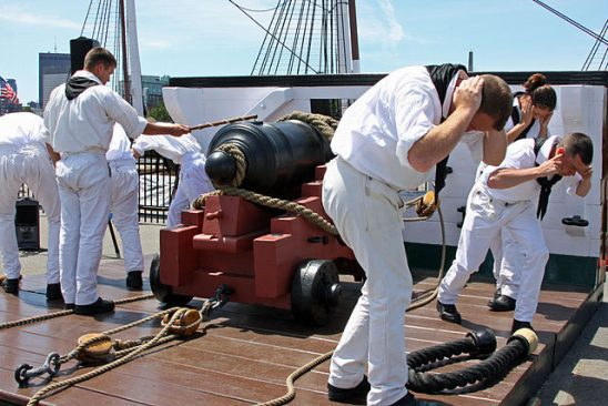 Sailors practicing cannon drills aboard USS Constitution.