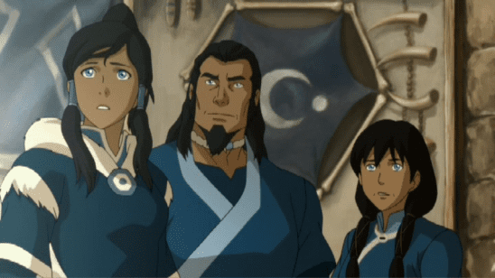 Korra standing with her parents.