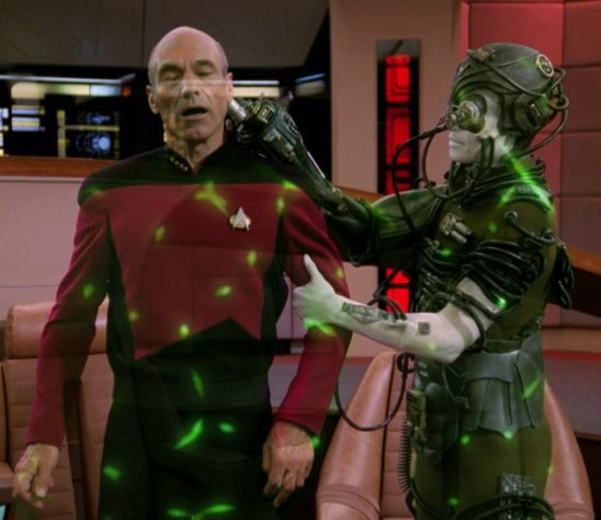 Picard being sedated and beamed away by the Borg.