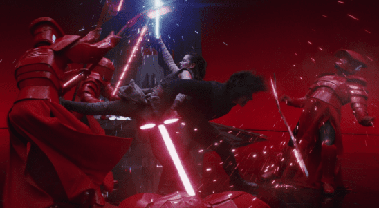 Rey and Kylo fighting Snoke's guards.
