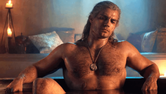 Geralt shirtless in a tub.