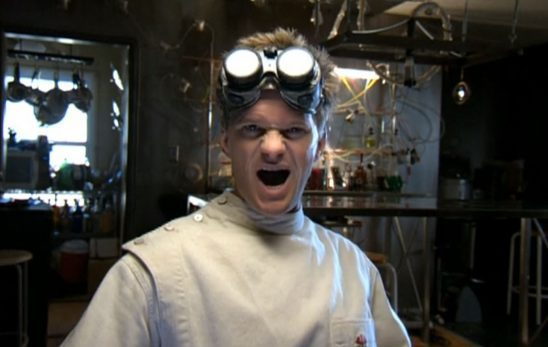 Dr. Horrible sneers at the camera as he laughs his evil laugh