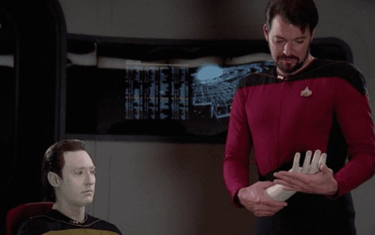Riker with Data's detached hand.