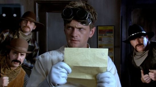 Dr. Horrible looks concerned as a he holds a letter from The Evil League of Evil.