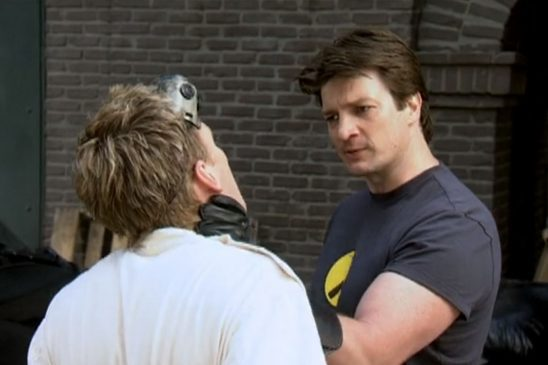 Captain Hammer grabs Dr. Horrible by the throat.