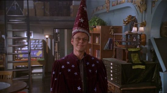 Giles in a silly wizard hat from Buffy the Vampire Slayer.