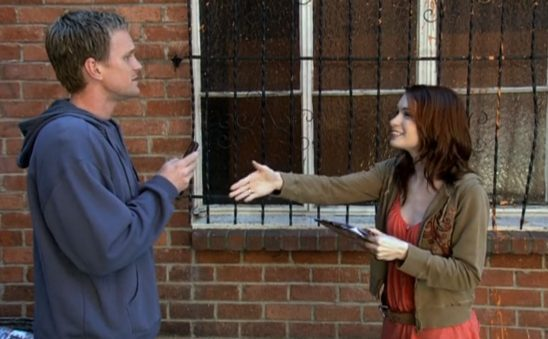 Penny smiles and reaches a hand out to shake Dr. Horrible's hand.