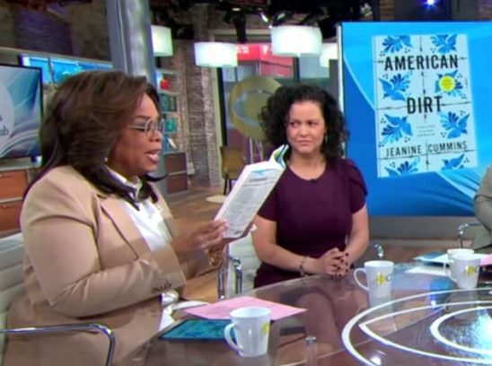Oprah reads American Dirt as she sits next to author Jeanine Cummins