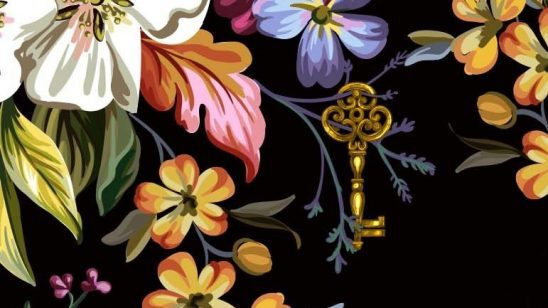 Flowers and a key from the cover of The Ten Thousand Doors