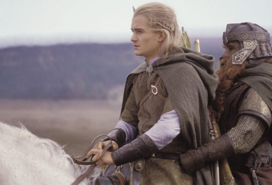 Legolas and Gimli together on horseback