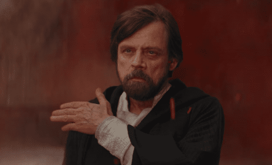 Luke brushing off his robe on Crait at the Last Jedi.
