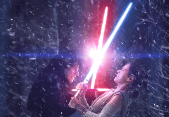 Kylo and Rey with lightsabers clashing.