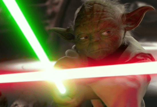 Yoda blocking Dooku's lightsaber with his own.