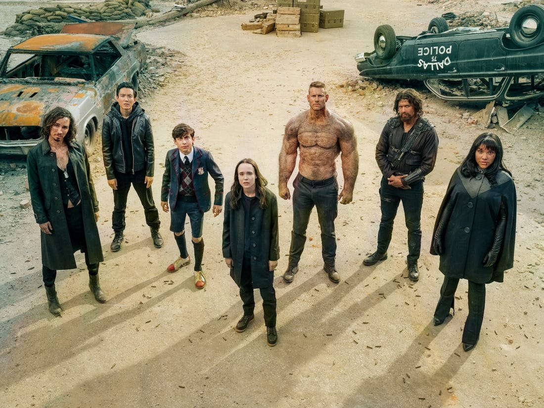 The Umbrella Academy characters standing on a ruined street.