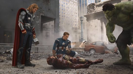 An unconscious Tony surrounded by Thor, Captain America, and Hulk.