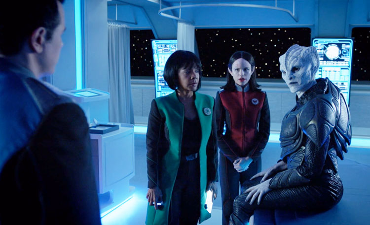 An alien woman sits in sickbay looking angry in The Orville