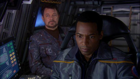 Riker in an Enterprise uniform with Mayweather.