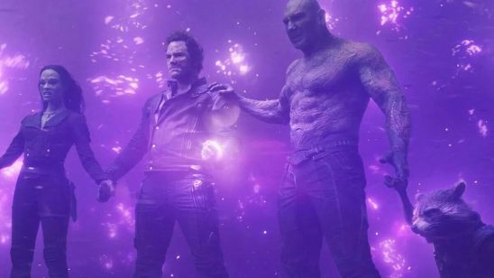 The Guardians characters holding hands.
