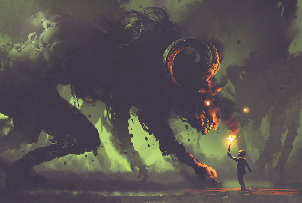 A person with a torch stands before an enormous demon