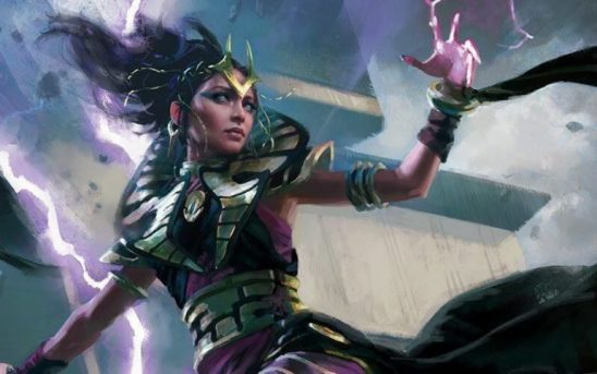 Art from the MTG card Shadowstorm Vizier, a woman with green armor wielding purple lighting.