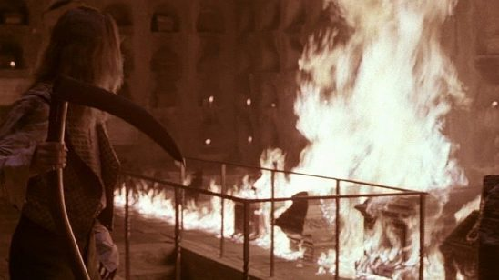 Louis with a scythe watching coffins burn.