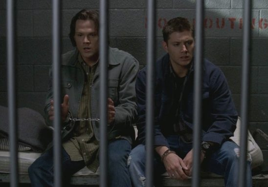 Sam and Dean in jail from the episode Jus In Bello.