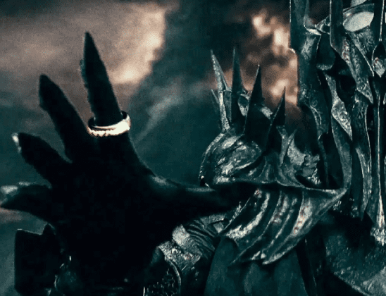 Sauron reaching out with the One Ring from Lord of the Rings.