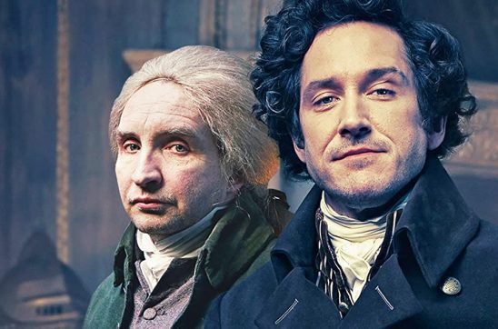 Strange and Norrell standing side by side from the TV show Johnathan Strange and Mr. Norrell.