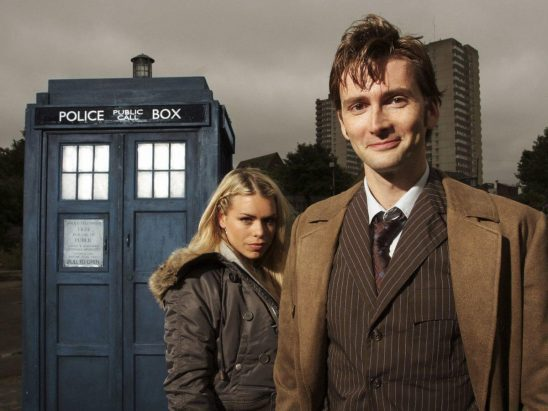The Doctor and Rose in front of the TARDIS from Doctor Who.