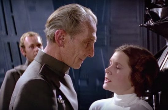 Tarkin staring down Leia while she closes her eyes in disgust.