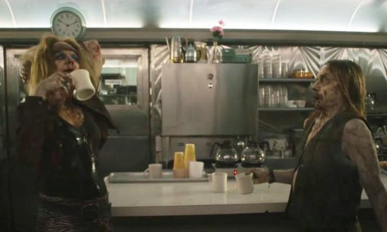 Two zombies pouring themselves coffee at a diner