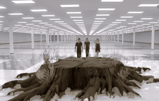 Several characters approaching the Nemeton inside a white room.