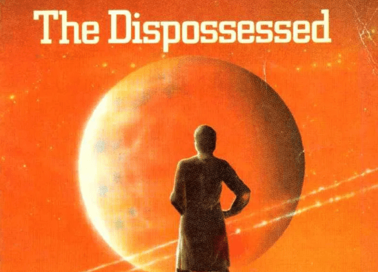 A silhouette against an orange sky from the Dispossessed cover art.