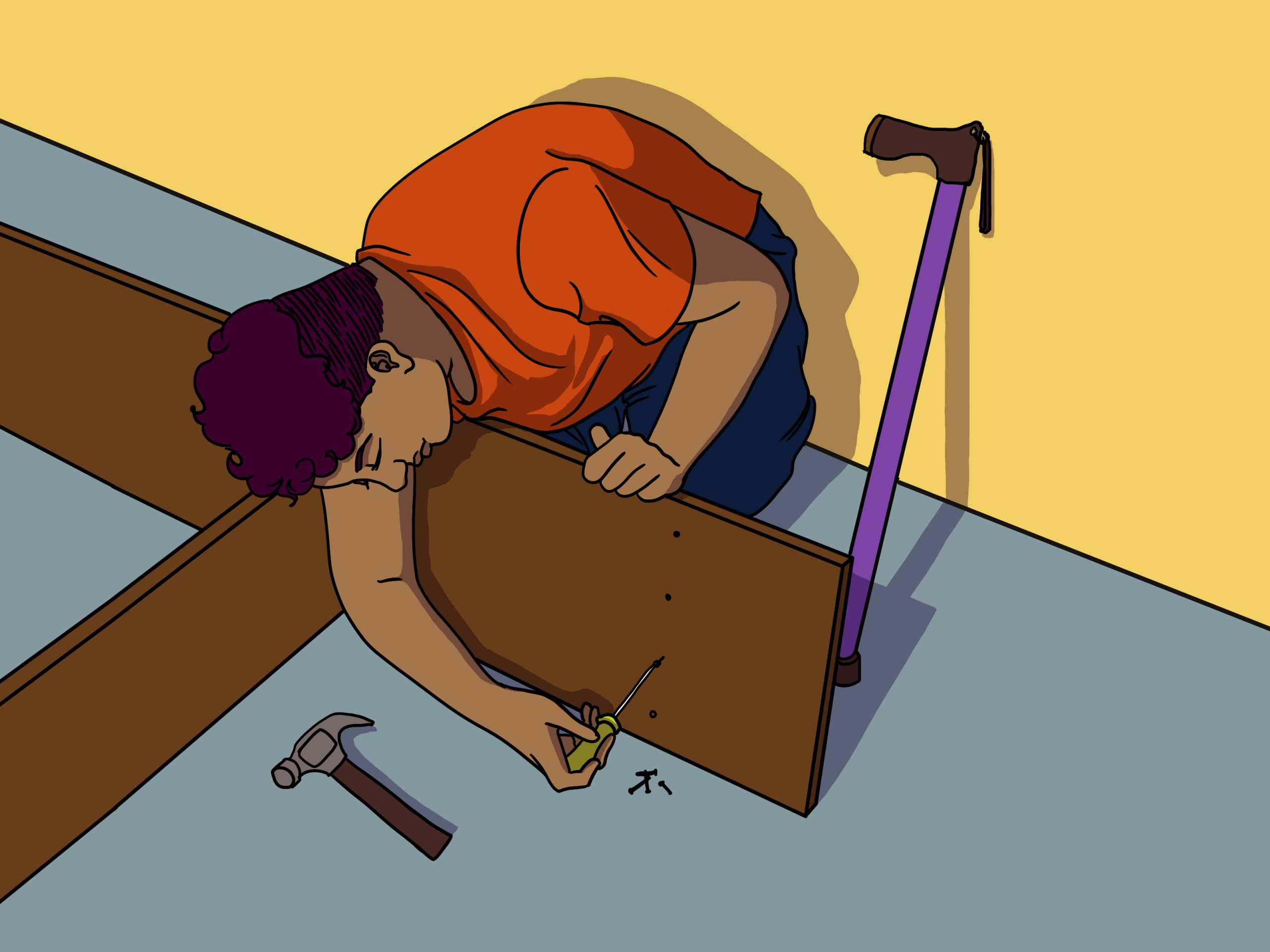 A Black woman with short, curly hair kneels on the floor, using a yellow screwdriver to fasten nails into a partially constructed bookcase. A few screws and a hammer are laid in front of her on the light blue floor. A purple cane is within reach of the woman, leaning against the yellow wall behind her.