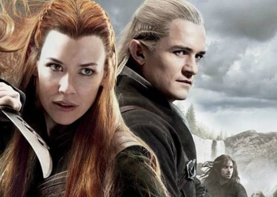 The elves Legolas and Tauriel stand in action poses, with the dwarf Kili in the background