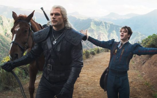 Jaskier the bard opens his arms wide as Geralt ignores him
