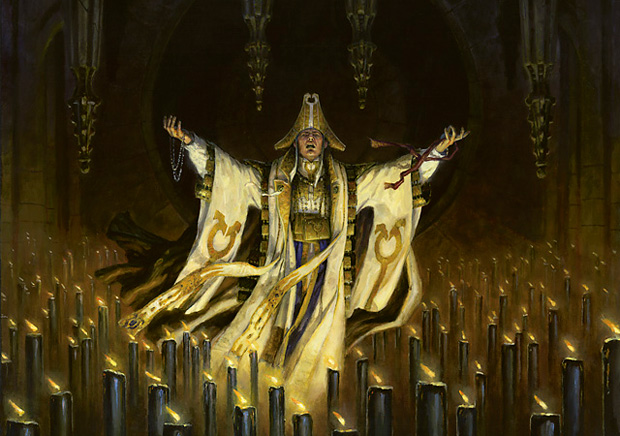 A robed man surrounded by candles.