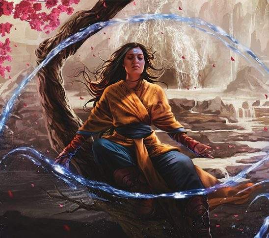 A woman meditating while surrounded by floating streams of water.