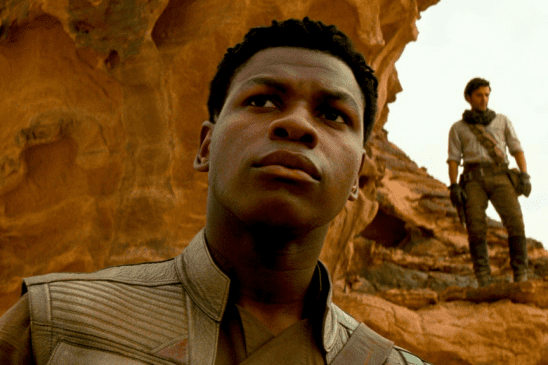 Finn with Poe in the background.