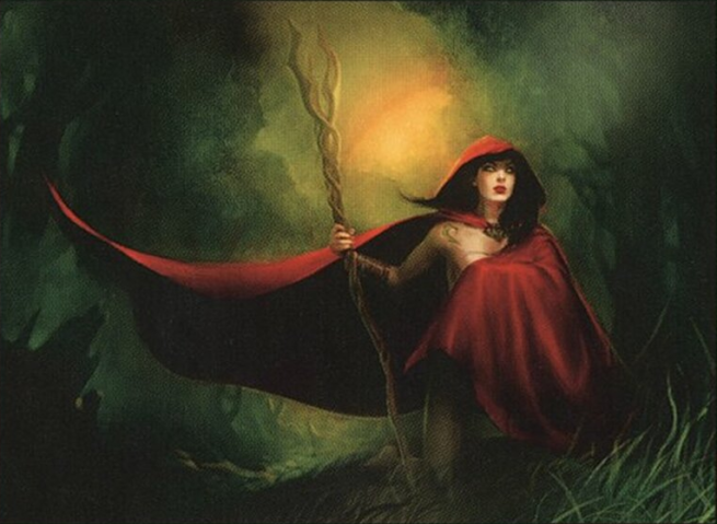 A woman with a red cloak and wooden staff.