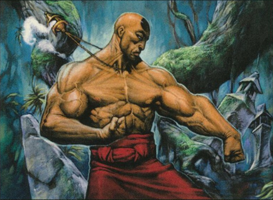A muscly shaved man in a punching stance.