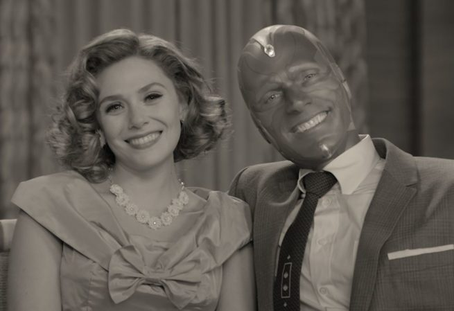 Wanda and Vision smiling in black and white.